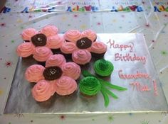 Flower Pull Apart Cupcake Cake...used 6 cupcakes as the flower petals instead of 5...made it into 3 individual flowers...used green pipe cleaners for the stems