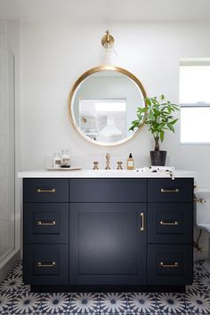 My plan is to swap out my builder grade bathroom mirror for something more fashionable... hopefully a round mirror!