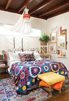 This boho bedroom has beautiful colors and textures to give it a vintage, ethnic feel. Boho style makes us #HomeGoodsHappy! Take our stylescope quiz to discover your own decorating personality. https://www.homegoods.com/stylescope/