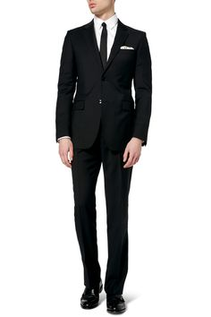 Funeral Outfits: What to Wear at a Funeral. For men, here is the classic look of the traditional black suit and tie.