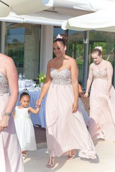 Blush for the adult bridesmaids and white for the little ones