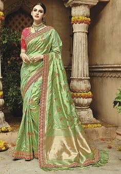 Beautiful and designer Banarasi Silk saree in Lime Green. This embroidered saree is decorated with designer border with tassels. Perfect choice for bridal wedding for the best look. Comes with Raw Silk Deep pink blouse piece. Indian Designer Sarees, Designer Sarees Online, Indian Sarees, Ethnic Sarees, Fancy Sarees, Party Wear Sarees, Green Saree, Art Silk Sarees, Traditional Sarees