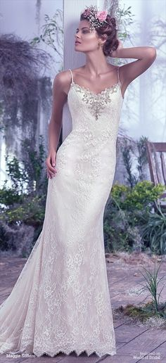 Understated elegance is found in this allover lace sheath wedding dress. Delicate beaded spaghetti straps and sweetheart neckline embellished with pewter embroidery, Swarovski crystals, pearls and beads add a sophisticated twist to this classic silhouette. Complete with a low scoop illusion lace back. Finished with crystal buttons over zipper closure.
