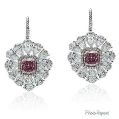 Avakian. A spectacular pair of earrings set with white pear shape diamonds and fancy intense radiant cut pink diamonds.