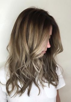 Want a low-maintenance look that will take you from summer to fall? Try a lived-in root with painted ends like this brunette and blonde fusion by stylist Olivia. Aveda hair color formula in comments.