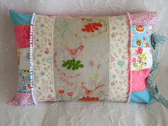 Very pretty quilted pillow, sweet embroidery as well. Love this idea!