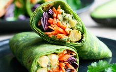 In this recipe, fresh, crunchy vegetables and a chickpea avocado mixture are wrapped up in a homemade spinach tortilla.