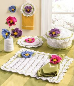 """Watch the Pansy Kitchen Set Crochet Pattern Product Review: Design by: Maggie Weldon Skill Level: Easy Size:Casserole Cover - Fits dish 7½"""" round, 3½"""" deep Potholder - about 9"""" round Placemat - about"""