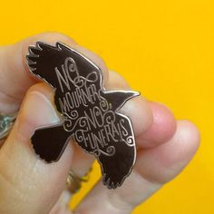 No mourners, No funerals. Inspired by an illustration/quote from The book Crooked Kingdom. Pin by Laserbrain Patch Co. 1 inch. Hard enamel with glossy silver co