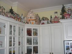 great place to display a Christmas Village - I decorate with garland every year and NEVER thought of putting my village up there!  I LOVE IT!