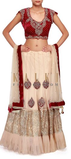 Buy Online from the link below. We ship worldwide (Free Shipping over US$100). http://www.kalkifashion.com/gold-lehenga-adorn-in-zari-and-kundan-embroidery-only-on-kalki.html