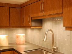 Elegant White Backsplash Glass Subway Tile With Simple Chrome Single Sink And Stainless Unique Mixer Taps And Laminate Wooden Kitchen Cabinet At Modern Small Space Kitchen Design