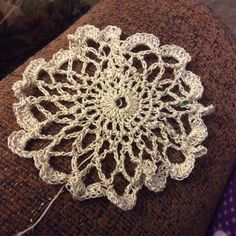 First doily! Thanks to Anne for the yarn thread