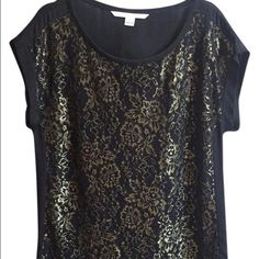 GORGEOUS DVF gold foil and black top Beautiful, sophisticated black silk short-sleeve DVF top with gold lam floral detail on the front. Loose but not oversize fit. Shell: 95% silk, 5% spandex. Decoration: 60% metallic, 40% nylon. Lining: 100% polyester. Diane von Furstenberg Tops Blouses