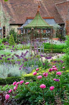 peonies and allum in the walled Tudor garden at Cowdray in West Sussex (Photo: Clive Nichols)