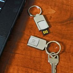 USB Keychain with Free Personalization.  Holds up to 4GB of data.  A perfect gift for your groomsmen.