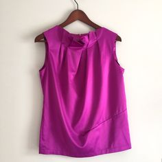 Purple top Used good condition. In European size 40, makes US size medium. 97 % polyester, 3% spandex. Super cute. I always got compliments with the color and unusual cut of this blouse Tops