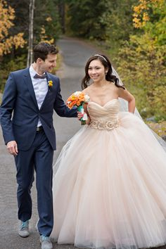This bride found a second gown she couldn't live without! See the wedding on SMP: http://www.StyleMePretty.com/canada-weddings/british-columbia/2014/02/05/whimsical-wedding-at-emerald-lake-lodge/ Photography: Orange Girl