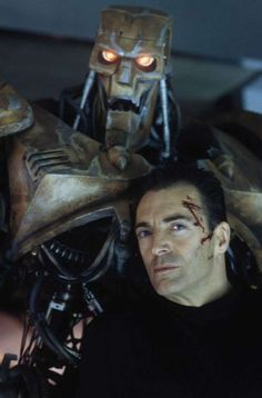 American actor Armand Assante as the psychotic Rico with his combat robot in the dystopian sci-fi film 'Judge Dredd', Photo: Richard Davis, Getty / 2011 Richard Blanshard Armand Assante, Combat Robot, Child Of The Universe, Judge Dredd, Sci Fi Films, Fantasy Characters, Fictional Characters, The Expendables, Hollywood Actor