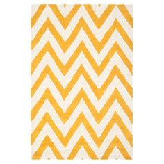 Hand-tufted wool rug with a chevron motif.  Product: RugConstruction Material: 100% WoolColor: G...