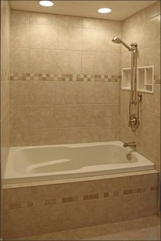 Bathroom:Minimalist White Tub With Brown Ceramic Bathroom Tile Plus  Stainless Steel Shower Also White Insert Storages Amazing Bathroom Showe.
