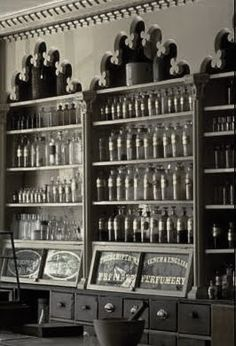 arch detail and apothecary bottles