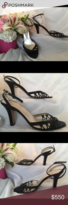 """Emporio Armani black heels w/ankle strap. Size 9. These fun summer sandals have a 4"""" heel with a dime size base and an ankle strap, making them easy to walk in and very stable. Interesting 'v' detail at the peep toe makes them stand out from the basic heels. Leather has a crocodile texture. No scrapes/scuffs on the heel or toe, only sign of wear is the bottom of the shoes. Great condition and have been leather conditioned recently. Don't let them get away, you know you have always wanted a…"""