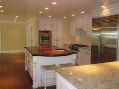 Kitchen.    Beautiful surface treatment - dark stained island contrast with light granite.