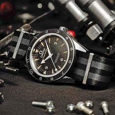 """ asks Vesper Lynd in Casino Royale, referring to timepiece. ""Omega"" comes Bond's reply, uttered with a tinge of satisfaction. The Omega Seamaster has been James Bond's timepiece of choice since but that wasn't always the case… Omega Seamaster 300 Spectre, Omega Watches Seamaster, Seamaster Watch, Daniel Craig, Craig James, Pasha De Cartier, Cool Watches, Watches For Men, Men's Watches"