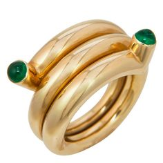 Tiffany & Co. Schlumberger Double Coil Ring. Circa 1990s Double Coil ring by jean Schlumberger for Tiffany & Company, set with 2 fine color cabochon Emeralds.
