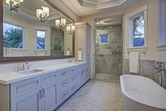 2019 Columbia Houston, TX 77008: Photo  Master Suite bathroom features marble floors, custom cabinetry, walk in shower and separate tub.