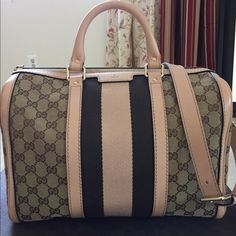 """Gucci GG Boston bag Medium top handle. Original GG canvas.  Sand/military green stripes w/ sand leather trim.  Double handles w/ 3.5"""" drop.  Adjustable/detachable shoulder strap w/ 20"""" drop.  Interior zip & smart phone pockets.  Zip-top closure.  13""""W x 8.7""""H x 7""""D.  Made in Italy.  Comes with dust bag, original Gucci care booklet, fabric swatch and box. Excellent condition.  Currently retails for $1350+tax.  No trades.  Serious buyers only.  More pics in separate listing. Gucci Bags"""