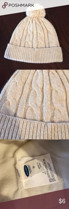 Girls Winter Hat Perfect Condition Girls Tan with gold sparkle throughout winter hat with Pom Pom on top. Size medium by Old Navy. The hat fits snug and no longer fits my 7 year old. Old Navy Accessories Hats