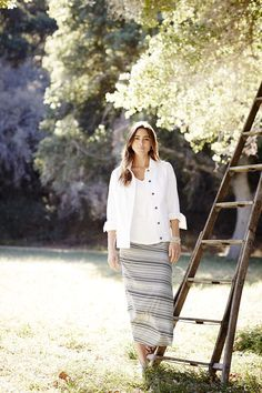 Seamed denim jacket and the striped knit wrap-style maxi skirt.
