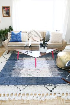 Layering Rugs With a Pop of Color via HelloLidy