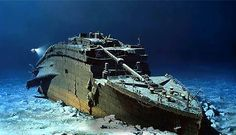 Simulated picture of Titanic's bow underwater, being investigated by an exploratory expedition.