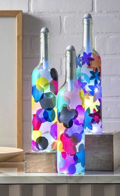 Wine Bottle Crafts: Light My Bottles! - Mod Podge Rocks - - If you love wine bottle crafts, these lanterns are easy to make with tissue paper and Mod Podge. The bottle lights are easy to install. Wine Bottle Lanterns, Empty Wine Bottles, Glass Bottle Crafts, Wine Bottle Art, Painted Wine Bottles, Lighted Wine Bottles, Diy Bottle, Bottle Lights, Bottle Lamps