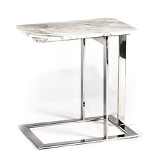 "This pretty little side table is perfect for any area in your home or office, with a beautiful white marble and stainless steel legs. Dimensions: 21.5""w x 15""d"