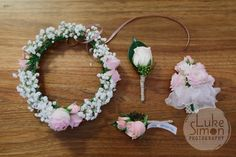 A lovely floral set, including flowergirl's wreath, lapel flower for the groom and mother of the bride wrist corsage