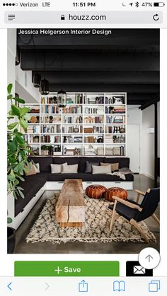 Could do a large built-in shelving unit and even have a library ladder! The addition of a barn door or two would add some really need style and appeal to it too
