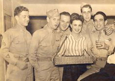 Cigarette girl and some soldiers c.1940s