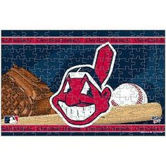 With this puzzle. When completed, the image boasts a team name on the top and a team logo on the left side for the perfect display of Indians pride! puzzle Approximately x High-quality team graphics A Team, Team Logo, Cleveland Indians, Cleveland Ohio, Mlb Merchandise, Ml B, Team Names, Puzzle, Display
