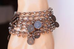 Brown Nylon Cord , shiny medium grey 4mm CZ glass beads Boho Crochet bracelet made extra long for you to wear it many ways. wraps about 8 times around the wrist or twice &three times around your neck.. Copper double side coins dangle along the crocheted chain The length is; approx 52