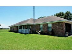 1104 CR 165 -Price: $399,000-This lovely 3/2 home sits on 45 acres located just outside of Caldwell. Country living with the convenience of city utilities! It has a 2 car attached garage plus a detached carport, open living, dining & kitchen. Has a wonderful screened in back porch to enjoy your morning coffee and enjoy your beautiful backyard view. Great property for your cows or horses! It's fenced around the perimeter of the home, cross fenced, large tank towards