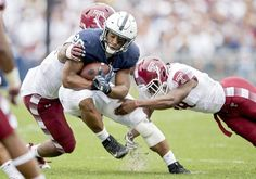 Temple defenders try to pull down Penn State running back Saquon Barkley during the Saturday, September 17, 2016 game in Beaver Stadium. Penn State won, 34-27.