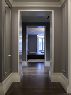 Baseboard Design, Pictures, Remodel, Decor and Ideas.  Slightly tapered baseboard gives a rounder shape to the base of the doorframe.