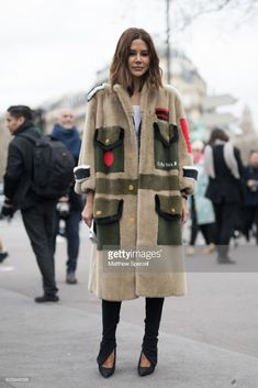 Christine Centenera is seen on the street attending Miu Miu during Paris Women's Fashion Week A/W 2018 wearing Miu Miu on March 6, 2018 in Paris, France.