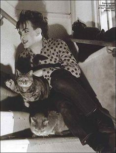 Robert Smith, lead singer of the cure, an object lesson in the dangers of too much make up and cat lover.