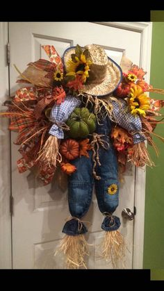28 wide scarecrow wreath. With pumpkins, fall flower greenery and his own personal crow. Overalls and shirt colors may vary as these are all toddler size cloths.