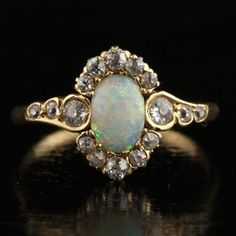 Antique Opal and Diamond Halo Ring  Art Nouveau by ArtifactVintage, $2675.00   ahhhhhhh hello!